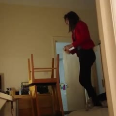 Girl Falls While Standing on Two Chairs to Change Lightbulb