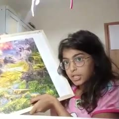 Girl shows her puzzle