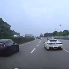 Idiot in Ferrari causes GTR to crash