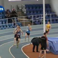 Runner gets tangled up in pole vault crossbars at the final stretch of race.