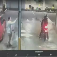 CCTV captured the moment a man damaged his motorbike at a car wash in ...