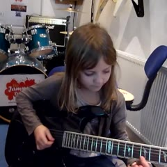 8_year_old_mini_band_guitarist_zoe_thomson_working_on_stratosphere