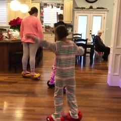 Girl does a long spin on hoverboard and faceplants