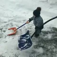 Helping his Dad shovel snow